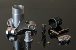 A selection of Metal Injection Moulded (MIM) parts ranging in weight from 0.265 g to 260 g. This sector of the Powder Metallurgy industry has achieved dramatic growth in the last decade. (Photo: Powder Injection Moulding International).