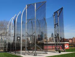 AAE's NCAA Recommended Height Hammer Discus Cage with view of Philadelphia skyline behind it.