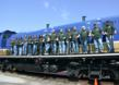 Jo-Ann Team Members pose on a locomotive at the Cuyahoga County Scenic Railroad where they cleaned engines and passenger cars.