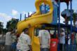 Residents and volunteers help with Playground Build event for Bayou Pass Village II in 2008.