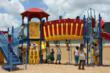 Neighborhood children enjoy the new playground they help designed.