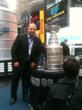 Stanley Cup is on display in Times Square, behind it is the 23-foot replica. Bryan Davis, Director of Sales is part of the security detail for the cup.