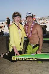 Kathy Chambliss, with Mark Schulein, whose paddleboard bore the name of her son, Bob,