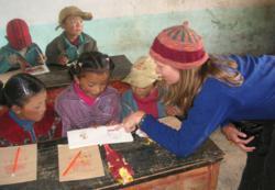 Conscious Journeys volunteer works with Tibetan students