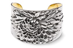 The sterling silver cuff by Repousse' Jewelry celebrates sunflowers and effortless chic.
