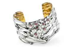 The silver cuff in Cherry Blossom motif from American Estate Jewelry.