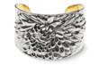 The sterling silver cuff by American Estate Jewelry gives her flowers every day.