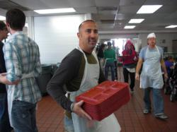 Mike Pousti serving food at a local homeless shelter