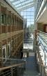 Balconies along Main Street atrium enter into large, open labs on upper floors