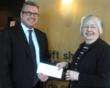 Kemptville District Hospital Auxiliary President, Bev Carson, presents a cheque for $50,000 to the Hospital's CEO, Colin Goodfellow