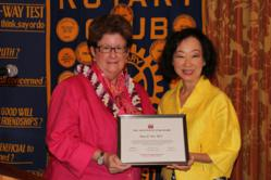 Penelope Paik, AICI Civility Co-Chair honors Nancy E. Pace, M.D. with Civility Award