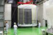 Acrylic chamber hoisted into position