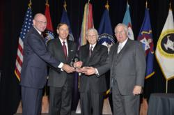 David H. Petraeus, retired Army General and current Director of the Central Intelligence Agency, is presented with the CGSC Foundation's 2012 Distinguished Leadership Award from Foundation leadership at a dinner banquet May 10, in Kansas City, Mo. From le