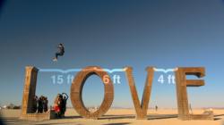 PJ Whitecotton at Burning Man doing Parkour on Love