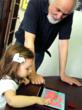 Morton Subotnick and child playing with the Pitch Painter iPad app