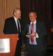 Mike Smith with Prodigital Corporation presents the Silver Marce Award to Otto Mehrgut.