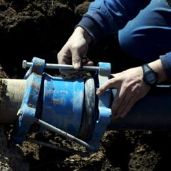 Technician fixing water pipeline
