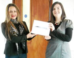 Eleanor Brown receiving her iPad® from Aisha Siddiq, Senior Account Manager at BIG.