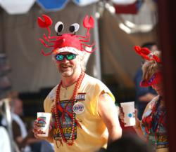 An image of festival-goers at the Mudbug Madness Festival in Shreveport.