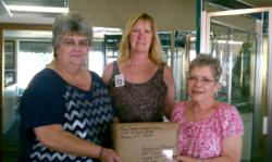 Glass Doctor of Central Carolina employees gather around their first pillow case shipment.