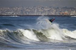 Timmy taking flight to his next room on Surfbreak Rentals