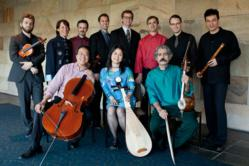 Group shot of the Silk Road Ensemble wtih Yo-Yo Ma