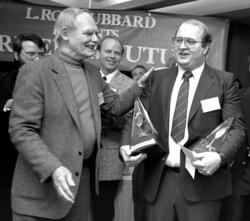 Frederik Pohl with L. Ron Hubbard Grand Prize Writer winner, Dave Wolverton, at 1987 Writers of the Future Awards ceremony at the Windows of the World restaurant atop the World Trade Center in New York City.