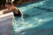 Woman relaxing in Cabin Bluff's Pool