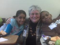 Sister Fran Gorsuch gathers with 6th graders during a career day in the East Ramapo School district, NY.