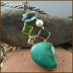 http://kvspasal.com/collections/sterling-silver/pendants/turquoise-blue-topaz