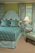Room using green ribbon as trim on pillows and draperies.