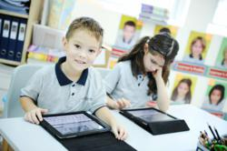 iPads in use in one of Stamford's KG2 classes. Children from KG2 to Grade 5 have 1 to 1 iPads and Middle School and High School students have 1 to 1 MacBooks to support the technology integration.