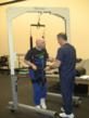 Bill Broglie, Physical Therapist at New Beginnings, works with Dennis, a 49 year old stroke patient, who learns to walk again using the Biodex Unweighing System.