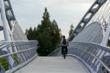 The bridge allows pedestrians and cyclists to safely traverse over eight lanes of traffic below