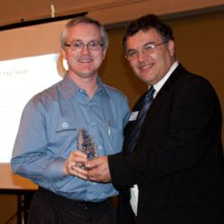 Robert Lavery representing Orchid Systems presenting reseller of the year award to Joseph Arnone, President BAASS Business Solutions Inc.