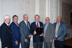"Senator Tom Carper receives ""Friend of Agriculture"" award by Farm Credit."