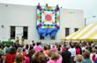 Last year's unveiling of the winner of AccuQuilt's Barn Quilt Design Contest. (Photo by Fremont Tribune.)
