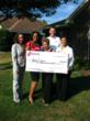 Neighborhood Credit Union leaders present $10K check to Joyce Davis of DeSoto