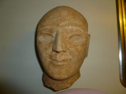 This Sumerian head is from the Third Dynasty of Ur, which existed from 21st to 20th century B.C. This unique piece has a bald head and with large wide-set eyes that were recessed to receive inlays. The eyebrows have also been recessed for inlays and form