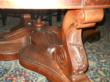 Elaborately carved mahagony legs of $60,000 riverboat table