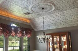 Victoria tin ceiling with a one foot design and a hand painted finish.