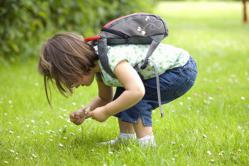 Child wearing Littlelife daysack with reins