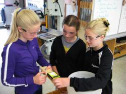 Students using a Wagner MMC220 Moisture Meter