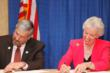 DU CEO Dale Hall (left) and Rebecca Rimel, president and CEO of The Pew Charitable Trusts, sign a 10-year partnership extension agreement.