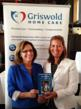 Griswold Home Care franchise owner Cathy Howard poses with author Randy Lee Griffin at a rebranding party.