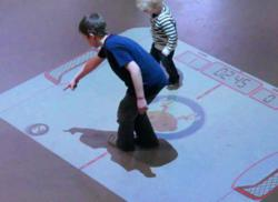 PO-MOtion interactive air hockey floor projection for Zunum Restaurant