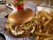 "South Philly Burger – a 100% Angus burger piled high with cheese steak ""imported"" from Philadelphia"