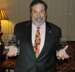 Mike with 2 First Place awards for excellence