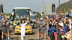 Day 27: Olympic Flame to visit Scottish Parliament and Bamburgh Castle on journey from Edinburgh to Alnwick
