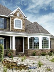 Manufactured stone siding that has easy, screw-in installation and a classic look.